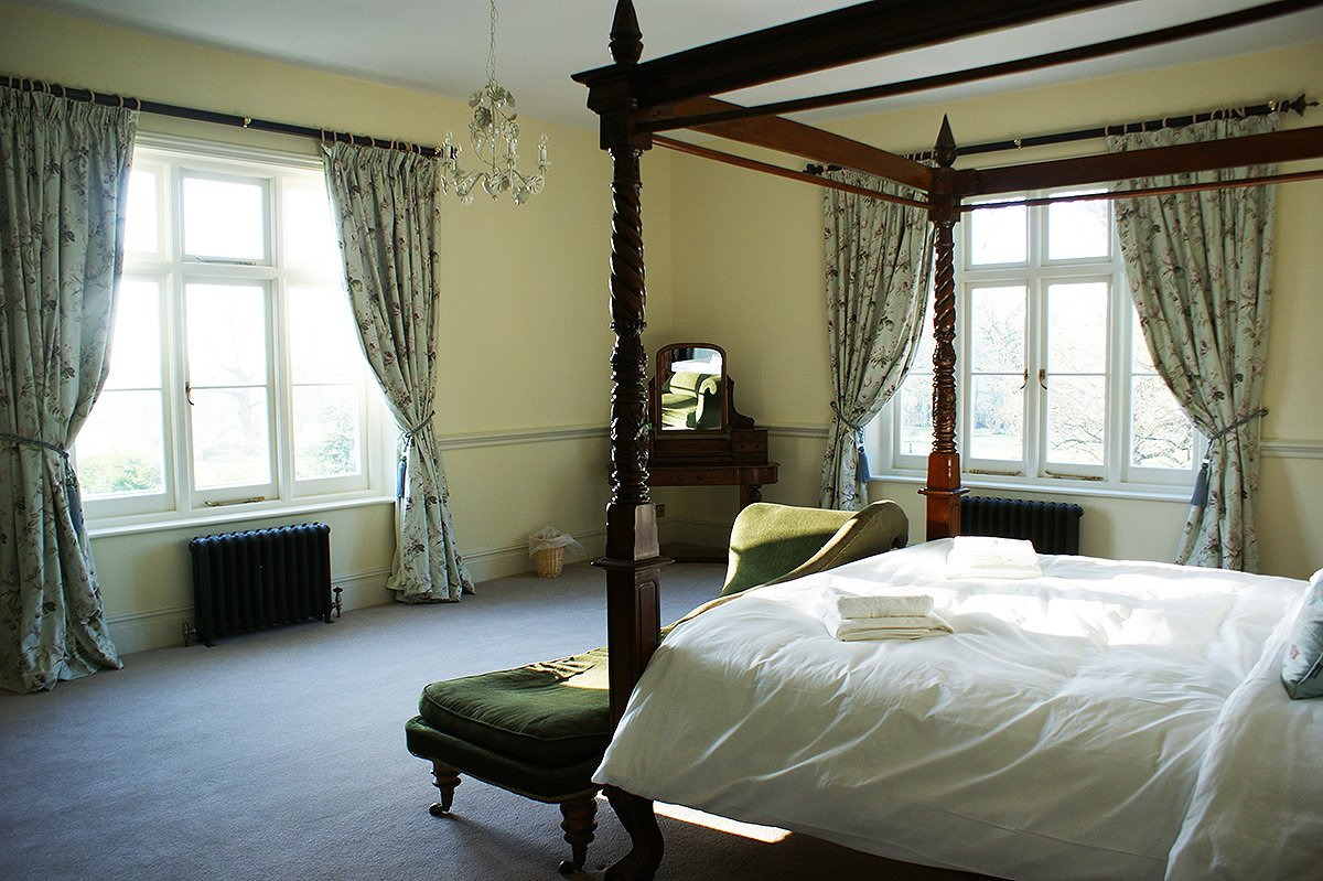 Bedroom 1 at Bessingham Manor.